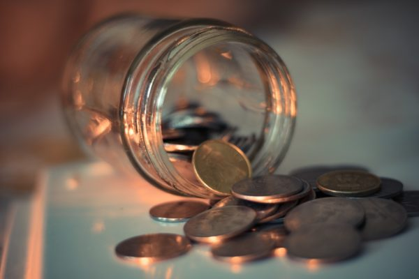 clear glass jar with coins