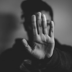 close-up photography of person lifting hands